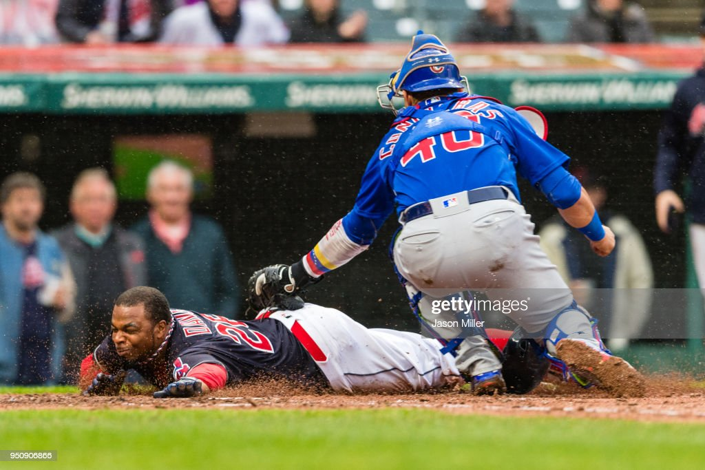 Rajai Davis #26 of the Cleveland Indians is tagged out at home by catcher Willson Contreras #40 of the Chicago Cubs to end the third inning at Progressive Field on April 24, 2018 in Cleveland, Ohio.