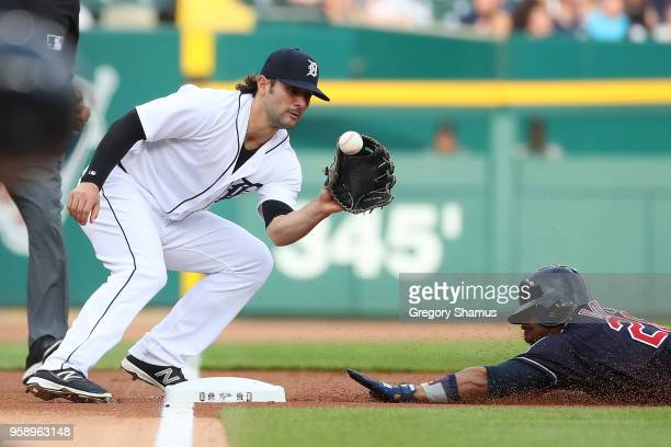 Rajai Davis of the Cleveland Indians slides into third base next to Pete Kozma of the Detroit Tigers during the first inning at Comerica Park on May...