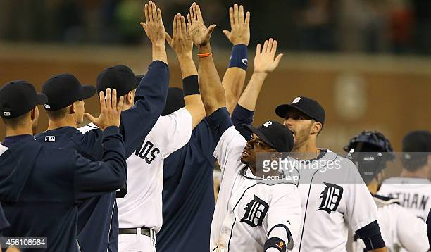 Rajai Davis of the Detroit Tigers celebrates a win over the Minnesota Twins with his teammates at Comerica Park on September 25 2014 in Detroit...
