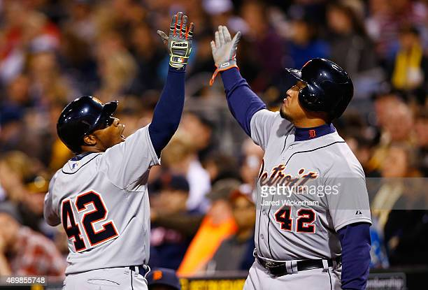 Rajai Davis of the Detroit Tigers celebrates his solo home run against the Pittsburgh Pirates in the sixth inning with teammate Miguel Cabrera while...