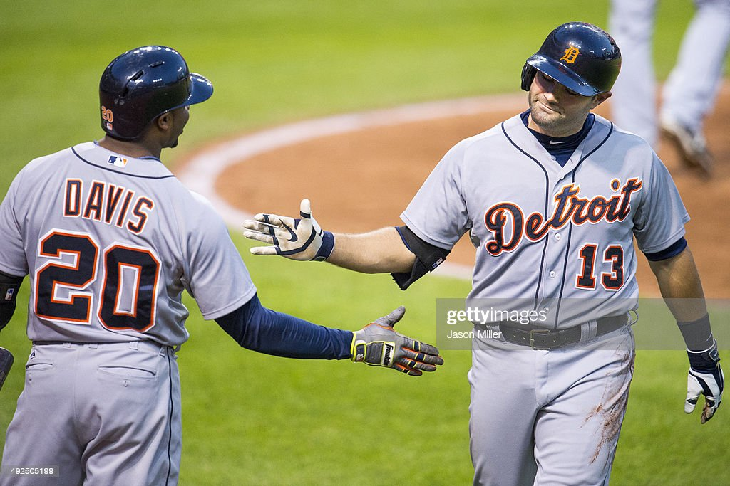 Rajai Davis #20 of the Detroit Tigers celebrates with Alex Avila #13 after Avila hit a solo home run during the fifth inning against the Cleveland Indians at Progressive Field on May 20, 2014 in Cleveland, Ohio.