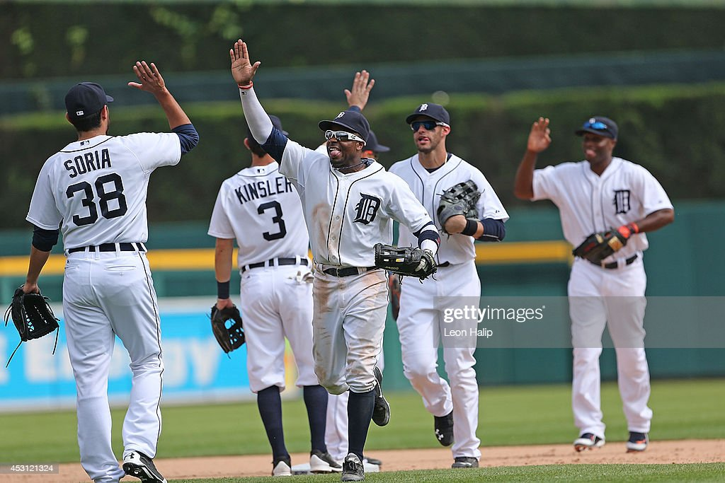 Rajai Davis #20 of the Detroit Tigers celebrates with his teammates after a win over the Colorado Rockies at Comerica Park on August 3, 2014 in Detroit, Michigan. The Tigers defeated the Rockies 4-0.