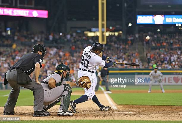 Rajai Davis of the Detroit Tigers hits a ninthinning grand slam to win the game over the Oakland Athletics at Comerica Park on June 30 2014 in...