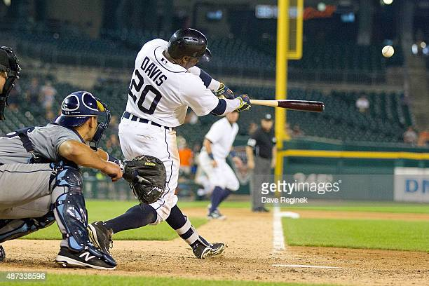 Rajai Davis of the Detroit Tigers hits a sacrifice fly in the thirteenth inning to drive in the winning run to defeat the Tampa Bay Rays 8-7 during a...