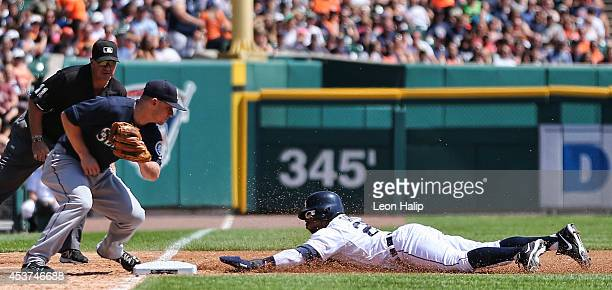 Rajai Davis of the Detroit Tigers slides safe into third base as Kyle Seager of the Seattle Mariners attempts to make the tag during the third inning...