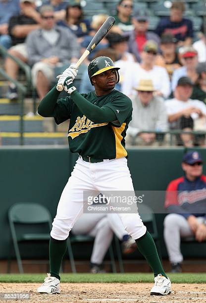 Rajai Davis of the Oakland Athletics bats against the Cleveland Indians during the spring training game at Phoenix Municipal Stadium on March 8 2009...