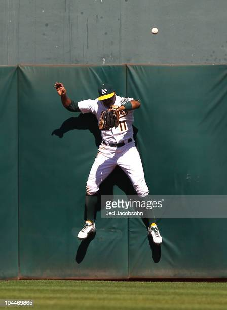 Rajai Davis of the Oakland Athletics can't reach a home run hit by David Murphy of the Texas Rangers in the sixth inning during a Major League...
