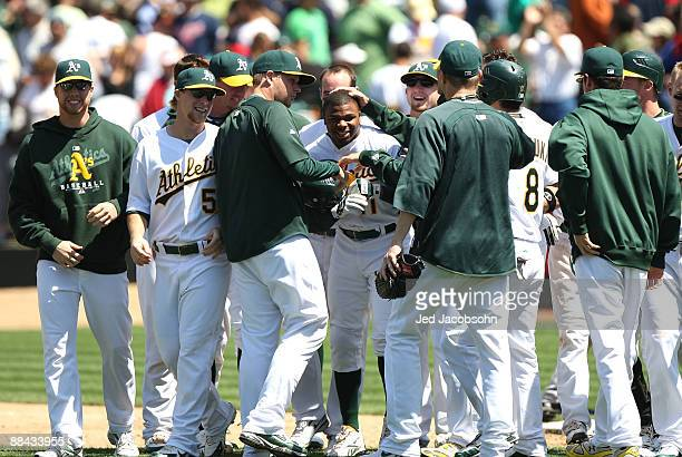 Rajai Davis of the Oakland Athletics celebrates after hitting the game winning single in the 9th inning against the Minnesota Twins during a Major...