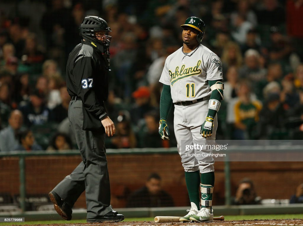 Rajai Davis #11 of the Oakland Athletics reacts after being called out on strikes by home plate umpire Carlos Torres #37 in the sixth inning of an interleague game against the San Francisco Giants at AT&T Park on August 2, 2017 in San Francisco, California.