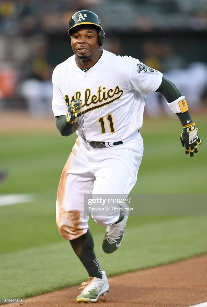 Rajai Davis #11 of the Oakland Athletics scores on a sacrifice fly from Jed Lowrie #8 against the Baltimore Orioles in the bottom of the first inning at Oakland Alameda Coliseum on August 10, 2017 in Oakland, California.