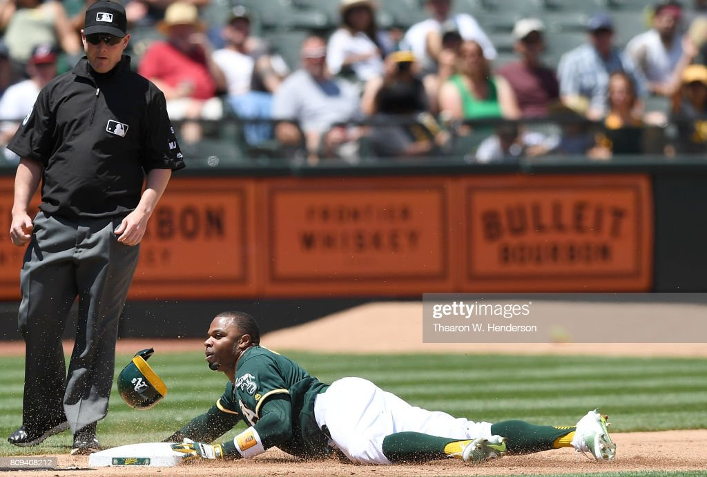 Rajai Davis #11 of the Oakland Athletics steals third base against the Chicago White Sox in the bottom of the fourth inning at Oakland Alameda Coliseum on July 5, 2017 in Oakland, California.