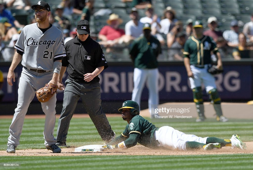 Rajai Davis #11 of the Oakland Athletics steals third base with out a throw down to third baseman Todd Frazier #21 of the Chicago White Sox in the bottom of the six inning at Oakland Alameda Coliseum on July 5, 2017 in Oakland, California. The stolen base was Davis's fourth of the game.