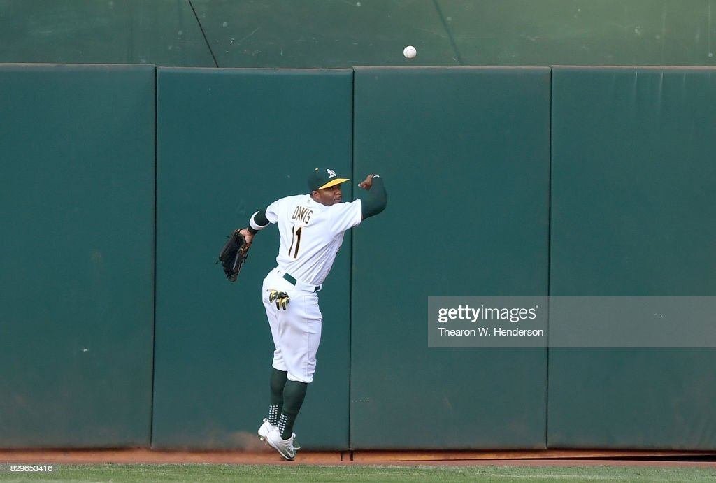 Rajai Davis #11 of the Oakland Athletics watches the ball hit off the base of the ball over his head for a lead off triple from Tim Beckham #1 of the Baltimore Orioles in the top of the first inning at Oakland Alameda Coliseum on August 10, 2017 in Oakland, California.