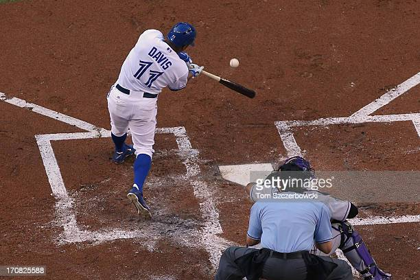 Rajai Davis of the Toronto Blue Jays hits an RBI double in the first inning during MLB game action against the Colorado Rockies on June 18 2013 at...