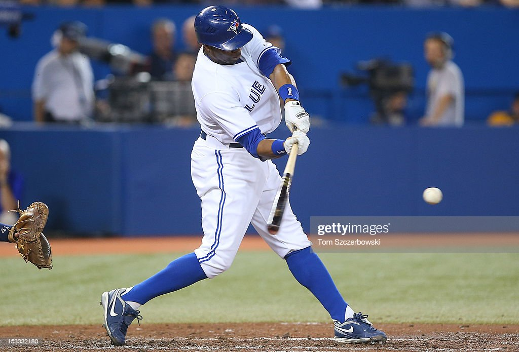 Rajai Davis #11 of the Toronto Blue Jays hits an RBI single in the third inning during MLB game action against the Minnesota Twins on October 3, 2012 at Rogers Centre in Toronto, Ontario, Canada.