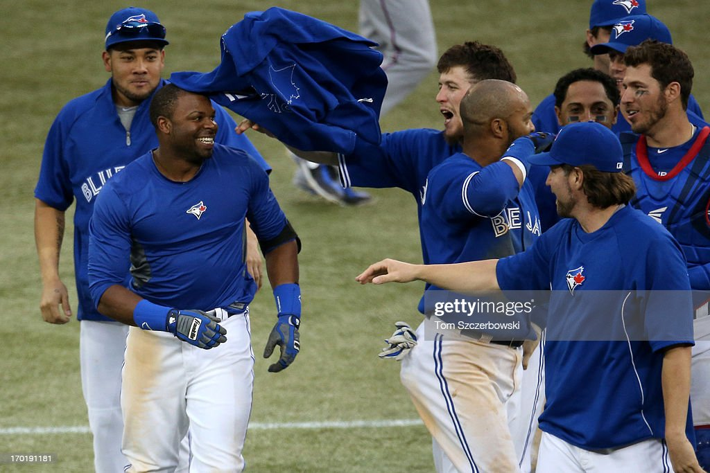 Rajai Davis #11 of the Toronto Blue Jays is congratulated by Colby Rasmus #28 after driving in the winning run in the eighteenth inning during MLB game action against the Texas Rangers on June 8, 2013 at Rogers Centre in Toronto, Ontario, Canada.