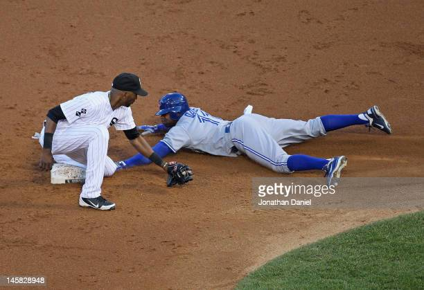 Rajai Davis of the Toronto Blue Jays is safe at second base on a steal as Alexei Ramirez of the Chicago White Six is late with the tag at US Cellular...