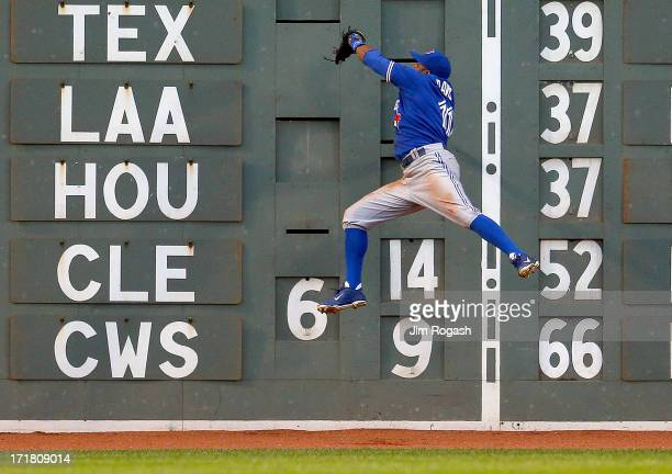 Rajai Davis of the Toronto Blue Jays makes a catch on a ball hit by Dustin Pedroia of the Boston Red Sox in the 3rd inning at Fenway Park on June 28...