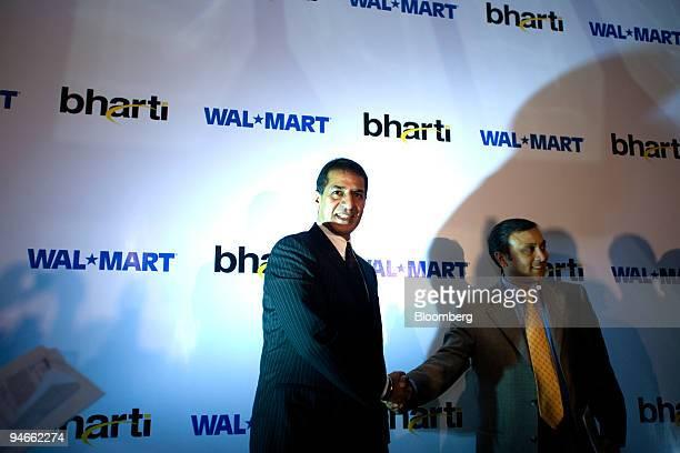 Rajan Mittal left joint managing director of Bharti Enterprises Ltd and Raj Jain president of emerging markets at WalMart's international unit shake...