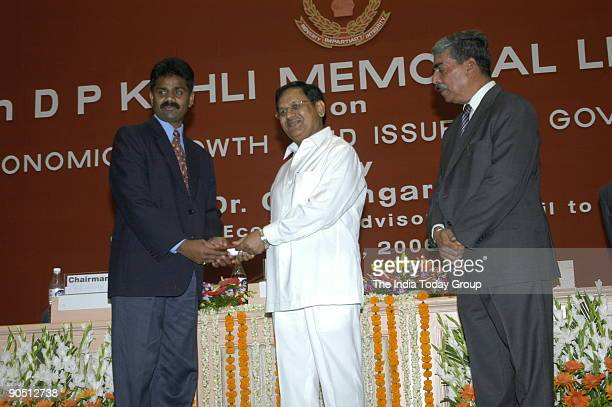 Rajasekhara of the CBI Anti Corruption Branch in Bangalore Receiving the Award from Suresh Pachouri Minister of State for Personnel and Parliamentary...