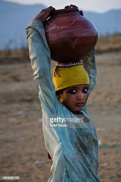Rajastani girl carrying water in a earthen pot.Access to potable water in India has increased strongly over the past decade.In rural areas the...