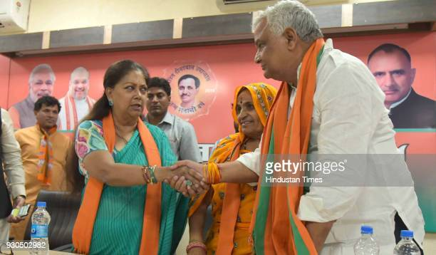 Rajasthan Chief Minister Vasundhara Raje greets NPP's state chief and Lalsot MLA Kirodi Lal Meena for joining BJP at party office on March 11 2018 in...