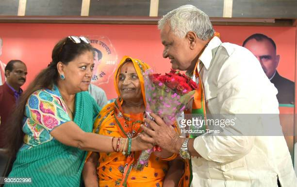 Rajasthan Chief Minister Vasundhara Raje welcomes NPP's state chief and Lalsot MLA Kirodi Lal Meena for joining BJP at party office on March 11 2018...