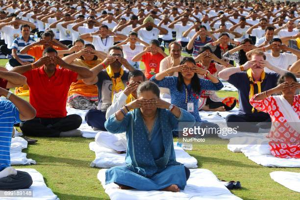 Rajasthan Chief Minister Vasundhara Raje with other participants take part in a yoga session during the 3rd International Yoga Day at SMS stadium in...