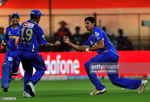 Rajasthan Royals bowler Siddharth Trivedi celebrates the wicket of Royal Challengers Bangalore batsman AB DeVilliers with his captain Rahul Dravid...