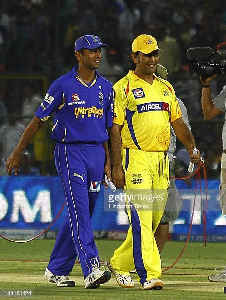 Rajasthan Royals captain Rahul Dravid and Chennai Super Kings captain M S Dhoni walks together after the toss at the ground as rain delayed play at...