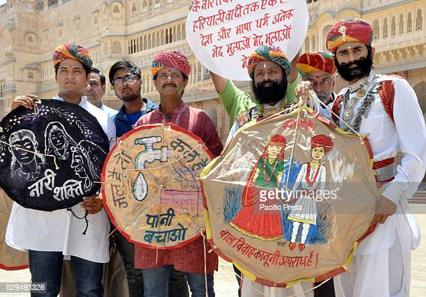 Rajasthani artists take part in an awareness campaign against child marriages on 'Akshaya Tritiya'