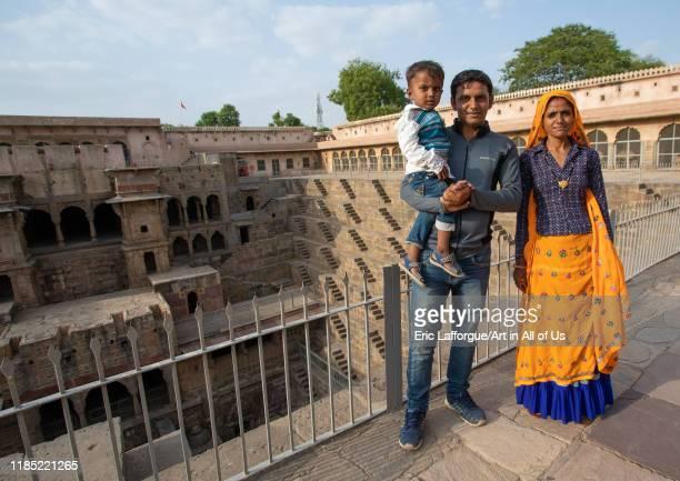 Rajasthani family in Chand Baori stepwell, Rajasthan, Abhaneri, India on July 14, 2019 in Abhaneri, India.