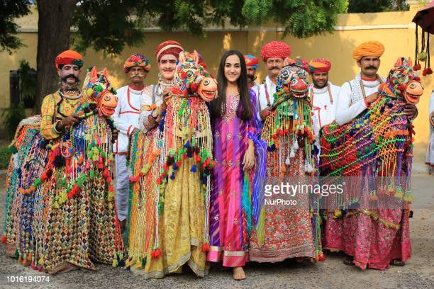 Rajasthani folk artists perform as they take part in a traditional 'Teej Procession ' in Jaipur Rajasthan India 13 August2018 Indian married women...