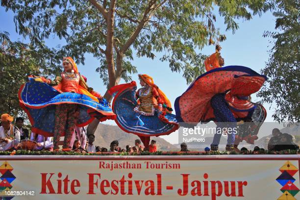 Rajasthani folk artists perform during Kite Festival on the occasion of Makar Sankranti at Jal Mahal in JaipurRajasthanIndia Jan 142019