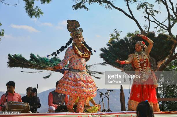 Rajasthani folk artists perform during the Kite Festival on the occasion of the Makar Sakranti Festival at Jal Mahal in Jaipur, Rajasthan, India....