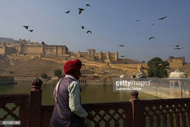 Rajasthani man in traditional dress in front of Amer Fort in Jaipur