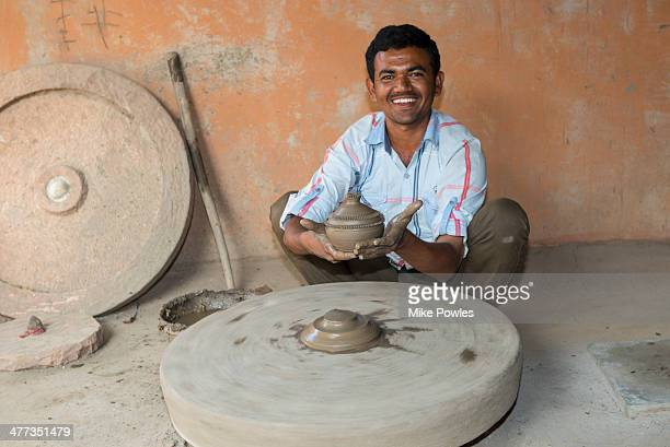 Rajasthani potter with finished pot, Jodhpur