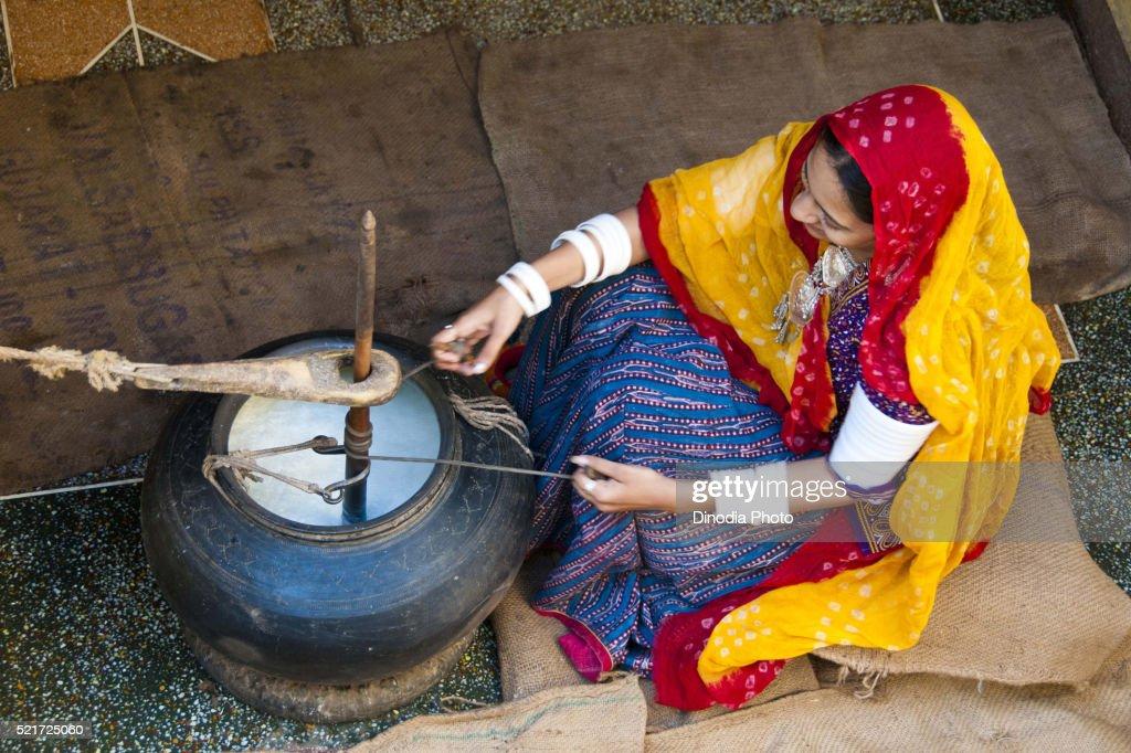 Rajasthani village woman churning butter milk, rajasthan, India : Stock Photo
