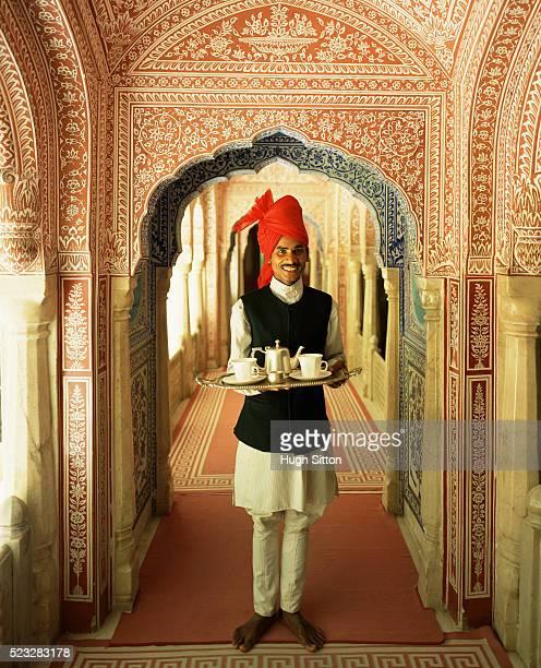 Rajasthani waiter holding tray