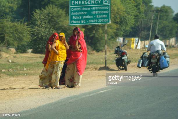 rajasthani womens waiting for bus - for stock pictures, royalty-free photos & images