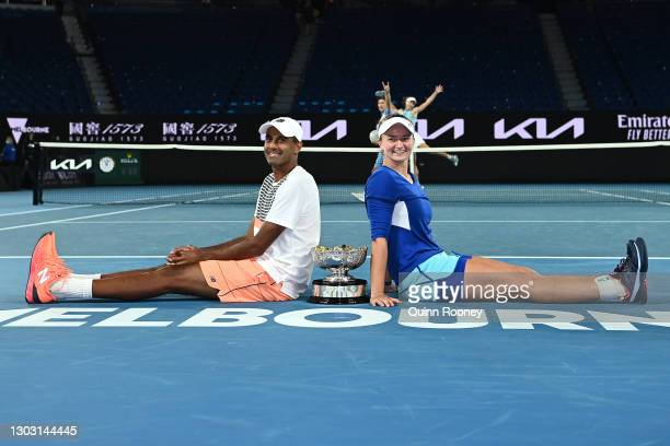 Rajeev Ram of the United States and Barbora Krejcikova of the Czech Republic pose with the championship trophy after winning their Mixed...