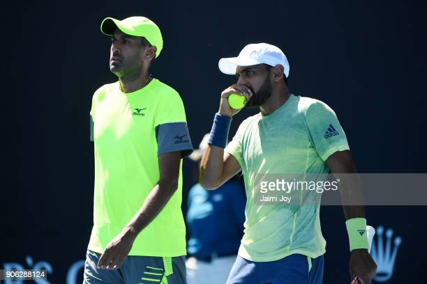Rajeev Ram of the United States and Divij Sharan of India and compete in their first round men's doubles match against Marius Copil of Romania and...