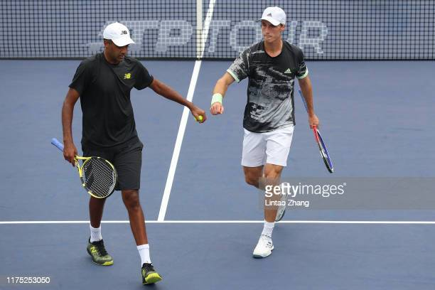Rajeev Ram of the United States and Joe Salisbury of Great Britain celebrate a match point during match against in the 2019 Rolex Shanghai Masters...