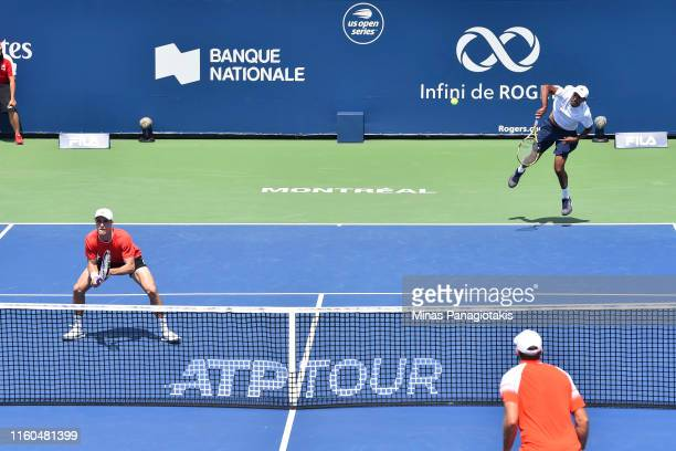Rajeev Ram of the United States and Joe Salisbury of Great Britain compete in their doubles match against Jeremy Chardy and Fabrice Martin of France...