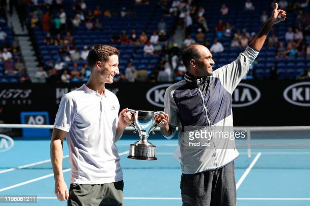 Rajeev Ram of the United States and Joe Salisbury of Great Britain hold aloft the championship trophy following their Men's Doubles Finals match...