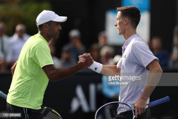 Rajeev Ram of the United States and Joe Salisbury of Great Britain celebrate after winning a point during their Men's Doubles first round match...