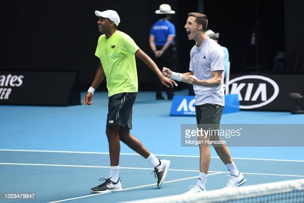 Rajeev Ram of the United States and Joe Salisbury of Great Britain celebrate winning championship point in their Men's Doubles Finals match against...