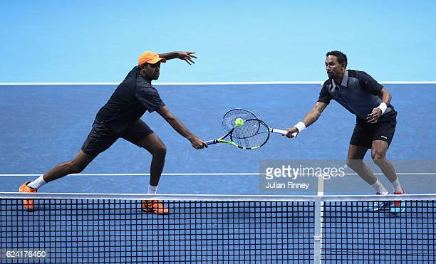 Rajeev Ram of the United States and partner Raven Klaasen of South Africa return the ball during the men's doubles match against Feliciano Lopez of...