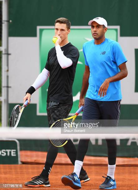 Rajeev Ram of The United States of America and Joe Salisbury of Great Britain play in their Men's Doubles second round match against Alex De Minaur...