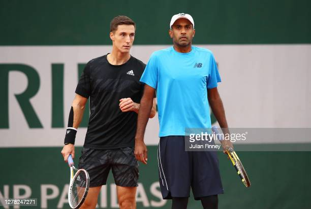 Rajeev Ram of The United States of America and Joe Salisbury of Great Britain play in their Men's Doubles third round match against Jeremy Chardy and...